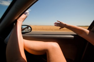 Girl Sticking Her Hands and Feet Out of the Window