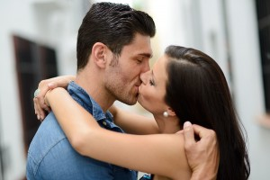 bigstock-Young-Couple-Kissing-In-The-St-45740968