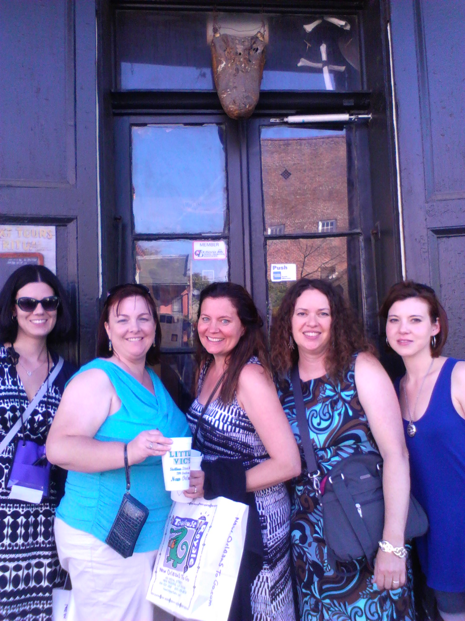 """Venturing into an """"authentic"""" voodoo museum: Sue Lyndon, Tish Beaty, Dawn Cosby, Lisa Medley and Amanda Buxton."""